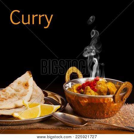Curry Concept - A Balti Dish With Chicken Curry With Visible Steam Rising, Served With Naan Bread An