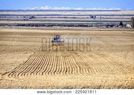 Tractor Planting Seeds In Farm Field In Southern Idaho