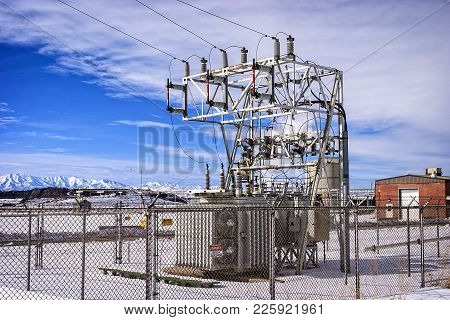 Electrical Power Substation Near Industrial Park During The Winter Months