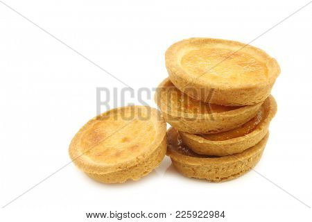 stacked  filled marmalade cakes on a white background
