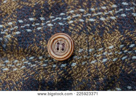 Brown Texture Of A Piece Of Clothing With A Button