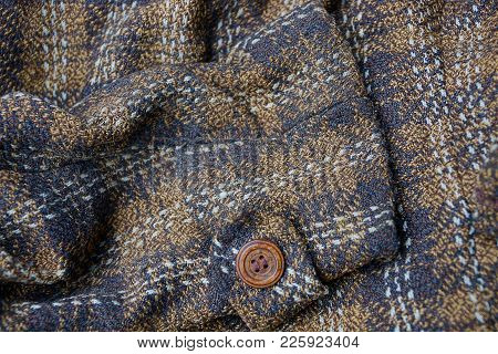 Brown Texture Of A Piece Of Clothing With A Button On The Sleeve