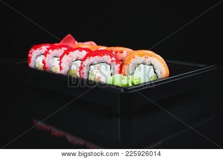Beautiful Rolls In The Black Container On Black Background With Reflection, For A Menu Or Website