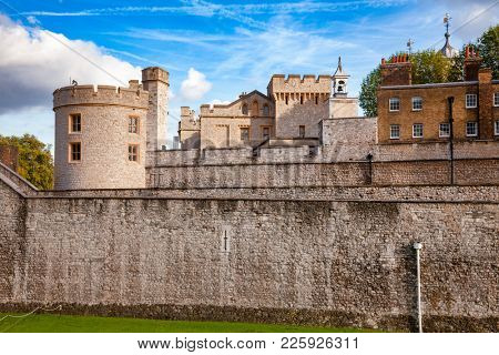 The outer curtain wall of Tower of London, a historic castle and popular tourist attraction on the north bank of the River Thames in central London England UK
