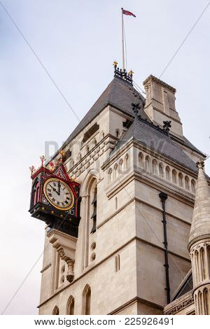 The Royal Courts of Justice (the Law Courts) Victorian Gothic exterior with clock, City of Westminster, Central Area of Greater London, UK