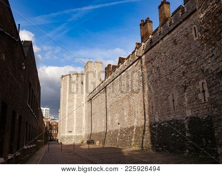 The Mint Street of Tower of London, a historic castle and popular tourist attraction on the north bank of the River Thames in central London England UK