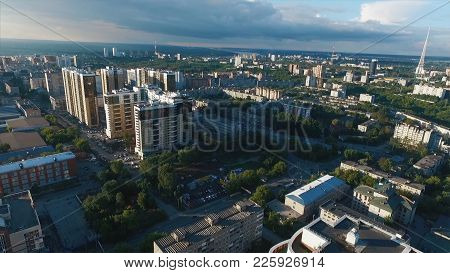 Business And Culture Concept - Panoramic Modern City Skyline Bird Eye Aerial View Under Dramatic Sun