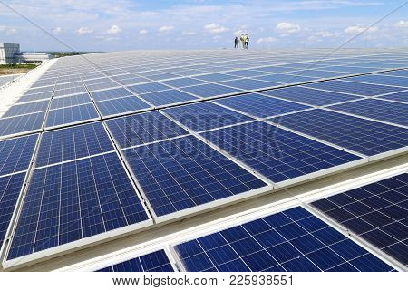 Solar Pv Rooftop With Workers Walking On