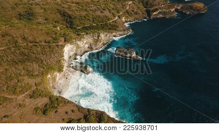 Aerial View Of Rocky Coast With High Cliffs, Sea Surf With Breaking Waves On The Coast, Nusa Penida,