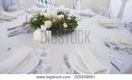 Banquet Decorated Table, With Cutlery. Wedding Decor In The Banquet Hall.serving Of A Festive Table,