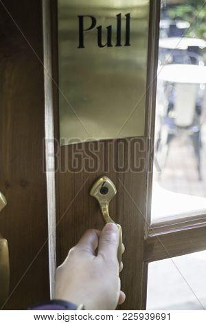 Hand Pull Door To Outdoor Seat, Stock Photo