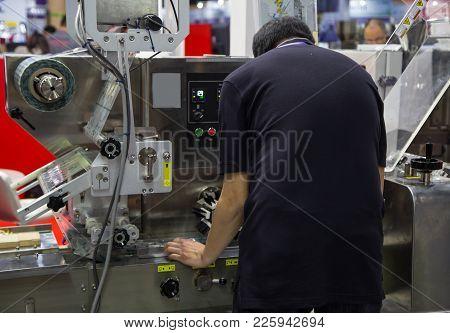 Food Worker Operate Food Packing / Sealing Machine