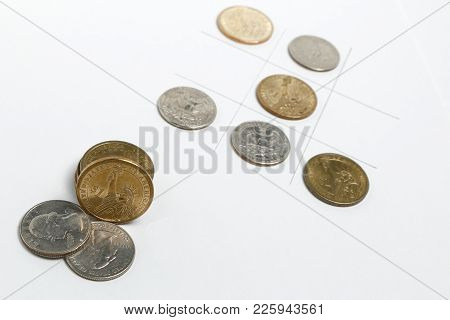 This Image Is A Closeup To Several Dollars Coins.
