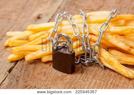 Ban On Potatoes For Diet And Cholesterol Reduction. The French Fries Are Wrapped Around The Chain An