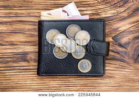 Wallet With Euro Bills And Euro Coins On Wooden Table. Business Concept. Top View.