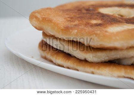 Traditional Russian Pasties Opened Circle Pie With Cheese. Close Up Cheese Pie,