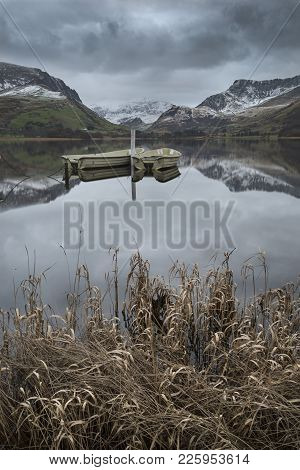 Beautiful Winter Landscape Image Of Llyn Nantlle In Snowdonia National Park With Snow Capped Mountai