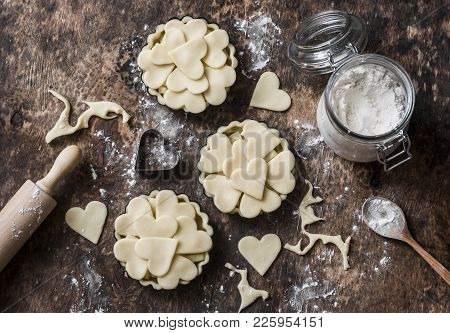 Flat Lay Valentine's Day Baking Background. Raw Apple Tartlets In The Baking Dish And Baking Ingredi