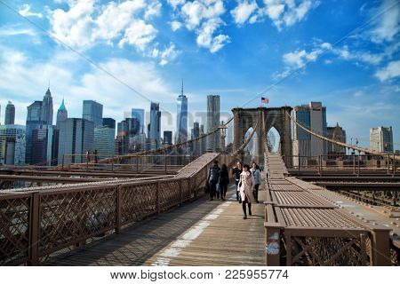 NY-USA, march 24, 2017:  People walking on the Brooklyn bridge, a suspended bridge in New York and one of the oldest bridges of either type in the United States. Completed in 1883.