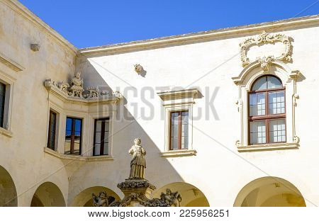 Lecce,  Italy - August 30, 2010: The Sculptures Of The Well And The Windows Of The Seminary Cloister