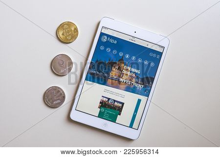 Budapest, Hungary - Feb 04, 2018: Show Three Coin: Bitcoin, Ethereum, Litecoin And A Tablet With Hun