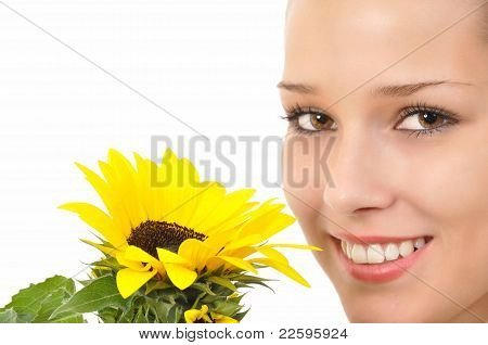 Pretty face with a yellow sunflower