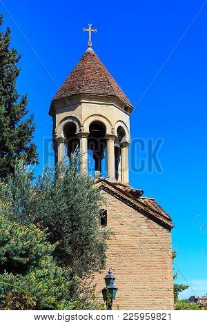 Bell Tower Of Sioni Cathedral Church In Tbilisi, Georgia And Trees