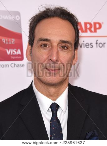 LOS ANGELES - FEB 05:  Alexandre Desplat arrives for the 2018 Movies for Grownups Awards on February 5, 2018 in Beverly Hills, CA
