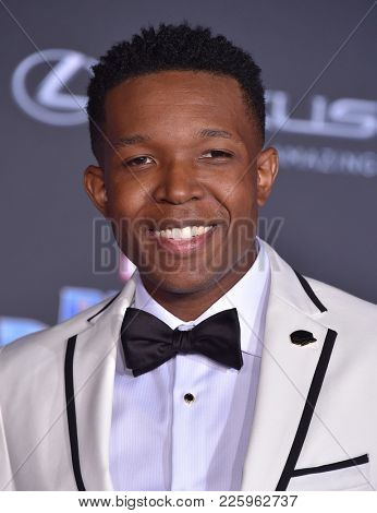LOS ANGELES - JAN 29:  Denzel Whitaker arrives for the 'Black Panther' World Premiere on January 29, 2018 in Hollywood, CA