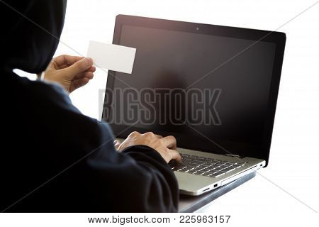 Hacker Is Hacking A Card By Using Old Laptop.