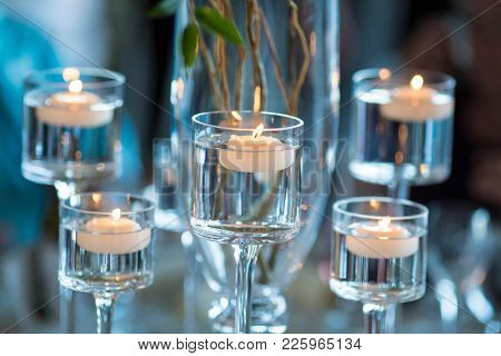 floating votive candles in stemware for reception