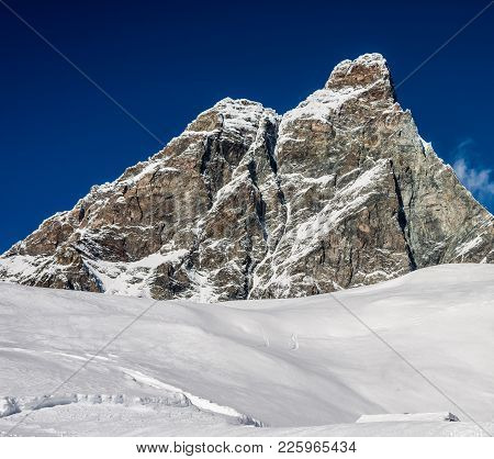 Empty Powder Filled Ski Slope Overlooking The Iconic Matterhorn Mountain