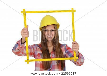 Young woman looking through a yellow ruler