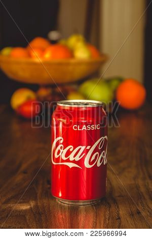 February 10th, 2018, Cork, Ireland - Coca Cola Can On Top Of A Wooden Table With Healthy Fruit In Th