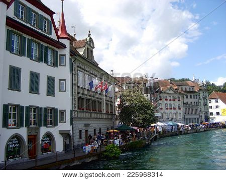 Lucerne, Switzerland - July 25, 2009 :historic City Center Of Lucerne With Beautiful Chapel Bridge A