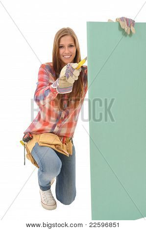 Craftswoman processed gypsum wallboard with a knife