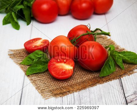 Fresh Tomatoes On A Table