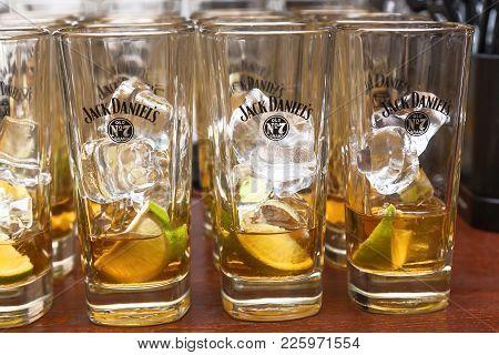 Ukraine Kiev May 14, 2016: Bottles And Glasses For Cocktail Jack Daniel Tennis Whiskey. Jack Daniel