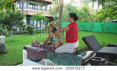 Asian Woman Massage Therapist Doing Massage To Girl. Summer Vacation On Luxury Spa Resort, Massage P