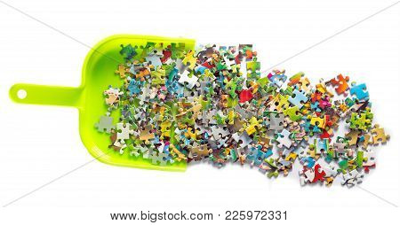Dustpan For House Work With Garbage Papers Puzzle Pieces