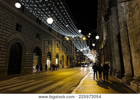 Rome, Italy - December 9 2017: Night Life In Rome. People Strolling On The Street In Central Rome To
