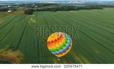 Aerial View Hot Air Balloon In The Sky Over A Field In The Countryside In The Beautiful Sky And Suns