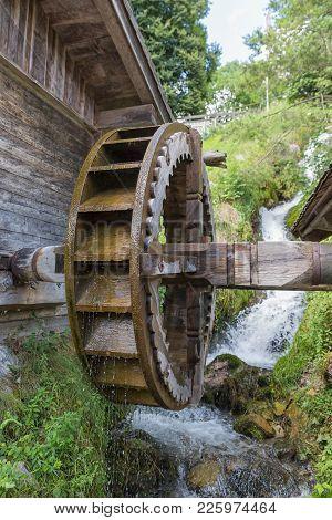 Traditional Wooden Waterwheel Near Werfen In Pongau Valley, Austria. The Water-wheel Was Used To Gen
