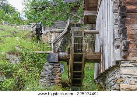 Traditional Wooden Waterwheel Near Werfen In Pongau Valley, Austria. The Water-wheel Was Used To Gen