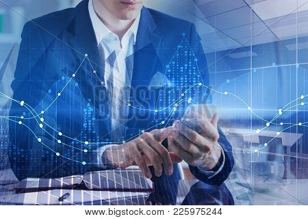 Businessman Using Smartphone With Digital Business Hologram On Abstract City Background. Technology,