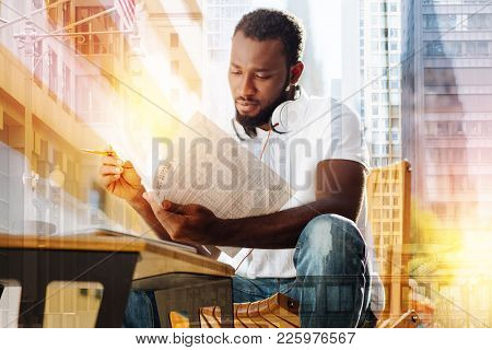 Diligent Student. Calm Clever Enthusiastic Student Looking Concentrated While Sitting In A Quiet Pla