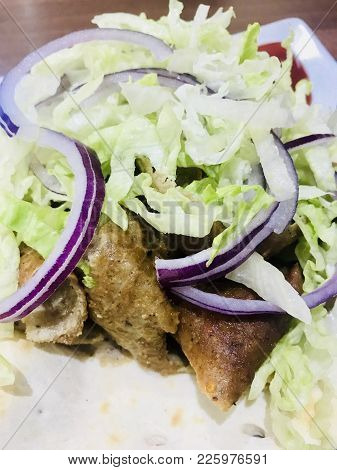 Lamb Doner Kebab Served With Salad In A Naan Bread