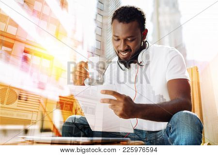 Tasty Coffee. Positive Smiling Diligent Student Having A Pleasant Afternoon While Sitting In A Nice
