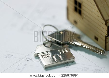 House Key With House Model Keychain On House Layout Plan
