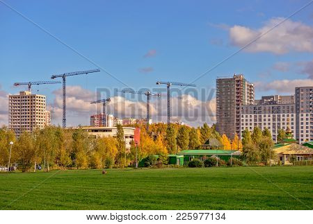 Building Of The Residential District Near Beutiful Green Lawn